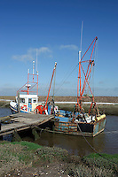 Fishing boat on Cow Bank Drain, Gibralta Point, Skegness, Lincolnshire