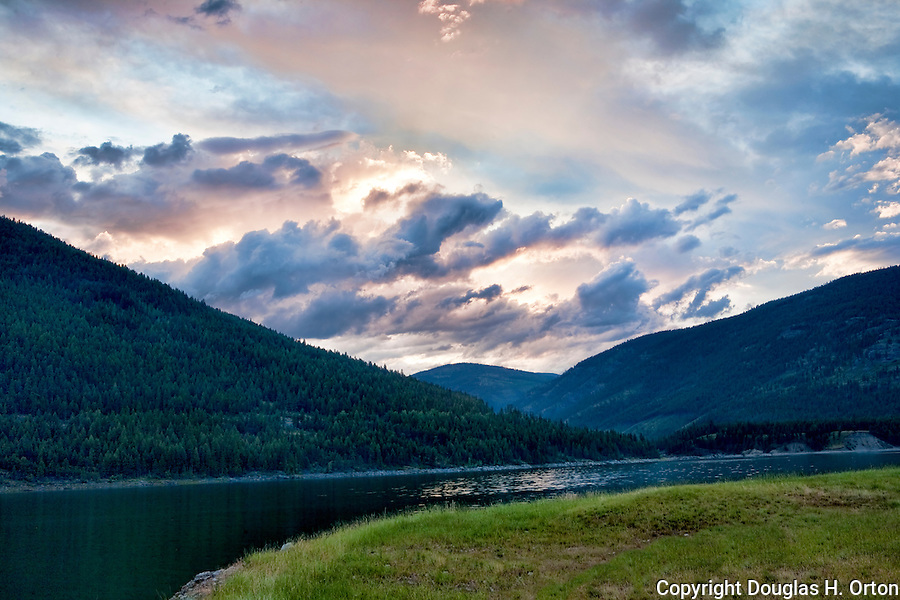 "Scenic Lake Koocanusa lies north of Libby, Montana and is formed by Libby Dam, blocking the Kootenai River and forming a resevoir nearly four hundred feet deep and fourty-eight miles long.  Scenic drives encircle the lake crossing over at the ""long bridge"", Montana's longest span."