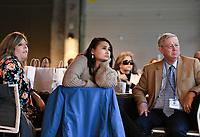 """NWA Democrat-Gazette/CHARLIE KAIJO Casey Wright, (from left) Rachelle Bishop and Leer Peter listen to speakers, Thursday, October 31, 2019 during the LatinXNA empowerment forum at The Record in Bentonville.<br /> <br /> The Latino Business Speakers Bureau partnered with Grand Slam Performance associates to bring nationally recognized speakers to Northwest Arkansas to share their best practices and insights to empower Latinos in business.<br /> <br /> Their goal is to create a movement within the local business community to commit to improve diversity numbers in businesses in the Northwest Arkansas region. This is the first year of the forum and was open to the public. <br /> <br /> """"Northwest Arkansas is a booming economy and is very attractive to Latino talent. There is a huge population gap for Latinos, 18 percent and representation at the C suite level is only 2 percent"""" said Carol Moralez, managing director of PerformanceGPA. """"We just want to see it move up at this stage. We want to drive movement in board development, Latino speaker engagements, c-suites, promotions and employee resource group impact (growing the Latino talent pipeline)."""""""