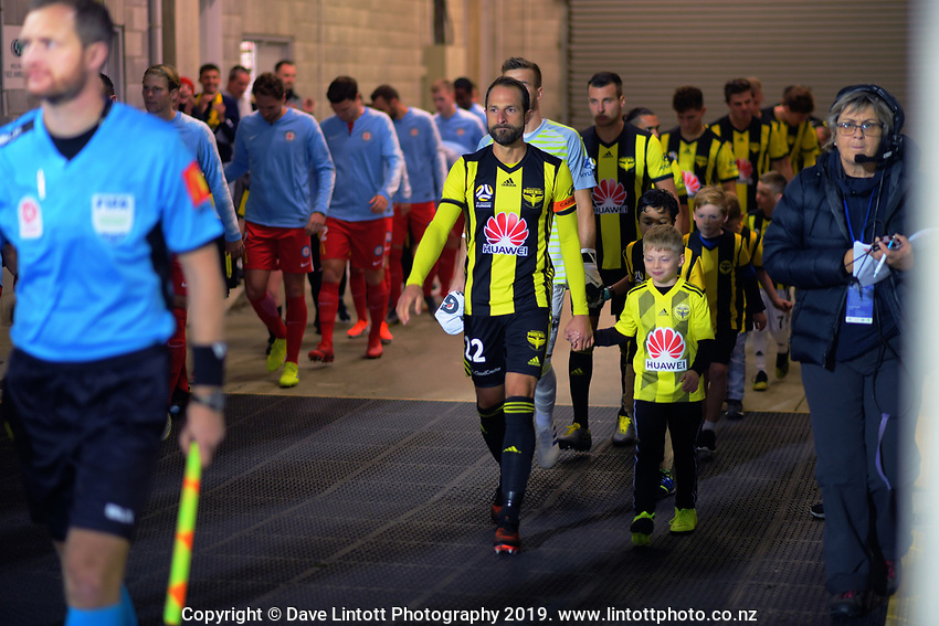 Phoenix captain Andrew Durante leads the Phoenix out for the A-League football match between Wellington Phoenix and Melbourne City FC at Westpac Stadium in Wellington, New Zealand on Sunday, 21 April 2019. Photo: Dave Lintott / lintottphoto.co.nz