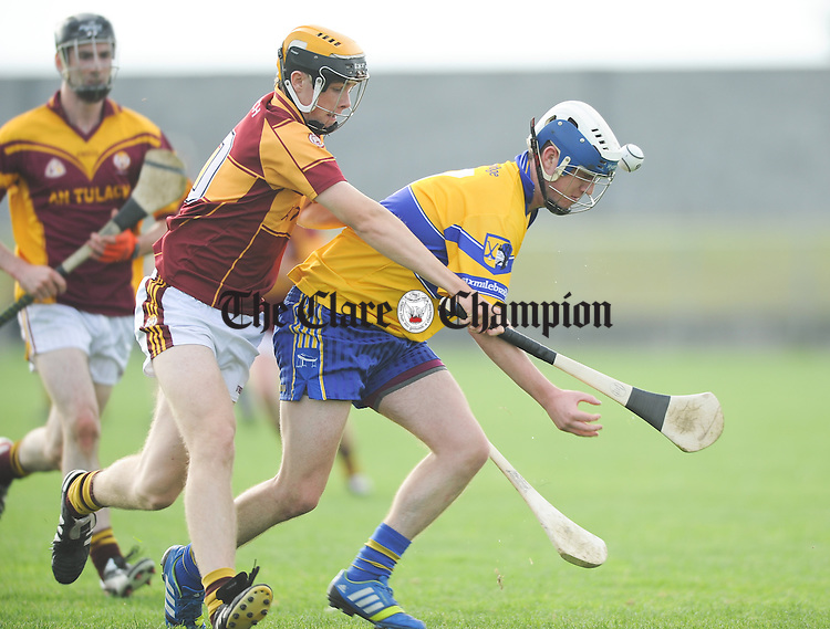 Dylan fleming of Sixmilebridge in action against Colin Corbett of Tulla during the Junior B hurling final at Clarecastle. Photograph by John Kelly