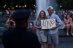 A couple are seen after de Dyke march in New York June 23, 2012. Photo by Kena Betancur / VIEWpress..