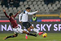 25th January 2020; Olympic Grande Torino Stadium, Turin, Piedmont, Italy; Serie A Football, Torino versus Atalanta; Luis Muriel of Atalanta scores the goal for 0-7 for Atalanta in the 88th minute while Koffi Djidji of Torino FC makes a desperate attempt at blocking his shot