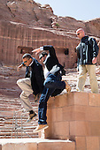 United States President Barack Obama and Dr. Suleiman A.D. Al Farajat, a University of Jordan tourism professor, jump from a ledge of the Nabataean Amphitheater during a walking tour of the ancient city of Petra in Jordan, March 23, 2013. .Mandatory Credit: Pete Souza - White House via CNP