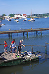 AT5CGF Family fishing for crabs on a wooden jetty River Deben Woodbridge Suffolk England