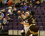 SIOUX FALLS, SD - NOVEMBER 25: Moira Duffy #34 from the University of Sioux Falls passes the ball while being pressured by Abuk Akoi #35 from Southwest Minnesota State University during their game Saturday evening at the Stewart Center in Sioux Falls. (Photo by Dave Eggen/Inertia)