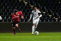 Monday 20 January 2014<br /> Pictured: Kenji Gorre ( with ball ) makes a run at goal<br /> Re: Swansea City U21 v Cardiff City U21 at the Liberty Stadium, Swansea Wales