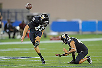 25 October 2011:  FIU kicker Dylan Lynch (49) kicks a field goal during pre-game warm-ups.  The FIU Golden Panthers defeated the Troy University Trojans, 23-20 in overtime, at FIU Stadium in Miami, Florida.
