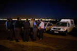 The City of Cape Town's Specialised Law Enforcement Services. The Vice Squad gather at 7pm on Saturday 24th April for an operational briefing from operational liaison officer Thomas Rautenbach, in a beach car park in the Table View area, with Table Mountain in the background.  The Squad has so far listed 49 illegal brothels that they officially know of in Table View, and for Saturday nights they plan to target 4 of these suspected brothels, with the hope to also find trafficked victims.