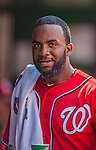 27 July 2013: Washington Nationals outfielder Denard Span smiles in the dugout after hitting a solo home run against the New York Mets at Nationals Park in Washington, DC. The Nationals defeated the Mets 4-1. Mandatory Credit: Ed Wolfstein Photo *** RAW (NEF) Image File Available ***