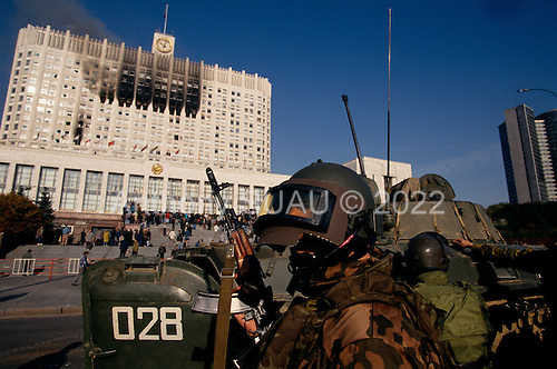 Moscow, Russia.October 4, 1993..Russian Special Forces take up position in front  of the Parliament building after Russian tanks fired directly into the face of the building. Hundreds of well armed anti-Yeltsin demonstrators surrender at dusk after killing several soldiers and holding the Russian Army at bay throughout the day. Numerous tank rounds were fired into the face of the building throughout the day with the upper floors catching fire and burning into the night...Russian troops surround the building and take control after killing or arresting the armed demonstrators.