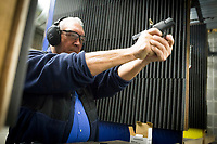 NWA Democrat-Gazette/CHARLIE KAIJO John Hundley of Garfield practices shooting, Friday, February 9, 2018 at Parker's Indoor Gun Range in Rogers.<br /><br />&quot;I just started here a couple weeks ago. Me and my grandson we target practice,&quot; Hundley said. &quot;I used to shoot in the military in 1970. Haven&Otilde;t done a whole lot since then.&quot;<br /><br />Hundley said he will be attending one of the concealed carry classes that Parker's Gun Range is hosting. A new enhanced carry law went into effect in January. He is part of a growing interest in concealed carry permits. <br /><br />The law allows concealed carry permit holders to carry their guns on to college campuses, bars and some public buildings. More than 70 concealed carry instructors received their certificates to teach the new 8-hour class in Arkansas. <br /><br />Parker's Gun Range hosts more than a dozen instructors who hold all or part of their concealed carry class including the shooting test at their range. The concealed carry class is a prerequisite for the enhanced class. Parker's will hold their first enhanced concealed carry class this Saturday. <br /><br />&quot;There's been a lot of phone calls, a lot of interest,&quot; Chuck Tripp, range safety office, said of the concealed carry classes. &quot;It&Otilde;s just been a steady growth. Classes are always full.&quot;<br /><br />All of the instructors who use Parker's range are either NRA certified instructors or NRA Range Safety officers Tripp said.
