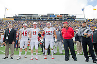 BERKELEY, CA - November 20, 2010: Stanford Athletic Director Bob Bowlsby, Team Captains Owen Marecic (48), Ryan Whalen (8) and Sione Fua (92) and John Elway during the Big Game against Cal in Berkeley, California. Stanford won 48-14.