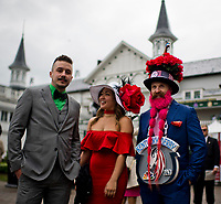 LOUISVILLE, KY - MAY 06: Two men and a woman dressed in their best attire pose for a photo on Kentucky Derby Day at Churchill Downs on May 6, 2017 in Louisville, Kentucky. (Photo by Scott Serio/Eclipse Sportswire/Getty Images)
