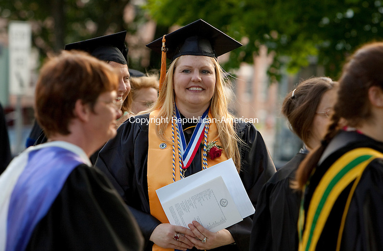 WINSTED, CT- MAY 27, 2010-052710JS03-Northwest Connecticut Community Technical College graduate Jeannette Niehaus of Barkhamsted makes her way to graduation ceremonies at East End Park in Winsted on Thursday. <br /> Jim Shannon Republican-American