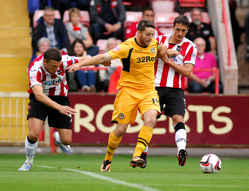 Exeter City's Danny Coles and team mate Craig Woodman battles with Newport County's Conor Washington<br /> <br /> Photo by Ashley Crowden/CameraSport<br /> <br /> Football - The Football League Sky Bet League Two - Exeter City v Newport County - Saturday 21st September 2013 - St James Park - Exeter<br /> <br /> &copy; CameraSport - 43 Linden Ave. Countesthorpe. Leicester. England. LE8 5PG - Tel: +44 (0) 116 277 4147 - admin@camerasport.com - www.camerasport.com