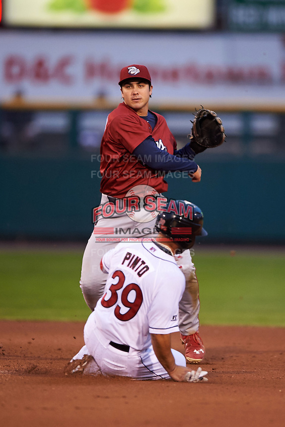 Lehigh Valley IronPigs shortstop Chase d'Arnaud (8) turns a double play as Josmil Pinto (39) slides in during a game against the Rochester Red Wings on May 15, 2015 at Frontier Field in Rochester, New York.  Rochester defeated Lehigh Valley 5-4.  (Mike Janes/Four Seam Images)
