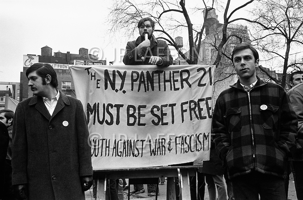 December 1969, Manhattan, New York City, New York State, USA --- American men belonging to the socialist group Youth Against War and Fascism in a 1970 demonstration demanding that the Black Panther 21 be freed. The Panther 21 were the leaders of the eastern region of the Black Panther party that were arrested and charged with conspiracy in 1969 and eventually acquitted of all charges in 1971. --- Image by © JP Laffont