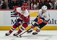 WASHINGTON, DC - JANUARY 31: Casey Cizikas #53 of the New York Islanders  checks Dmitry Orlov #9 of the Washington Capitals during a game between New York Islanders and Washington Capitals at Capital One Arena on January 31, 2020 in Washington, DC.