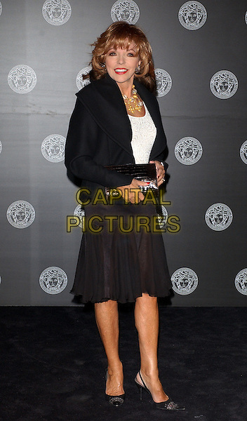 JOAN COLLINS.Versace Store Re-Launch Party During London Fashion Week 2005 at their store on Sloane Street..September 19th, 2005.full length black skirt jacket clutch.www.capitalpictures.com.sales@capitalpictures.com.© Capital Pictures.