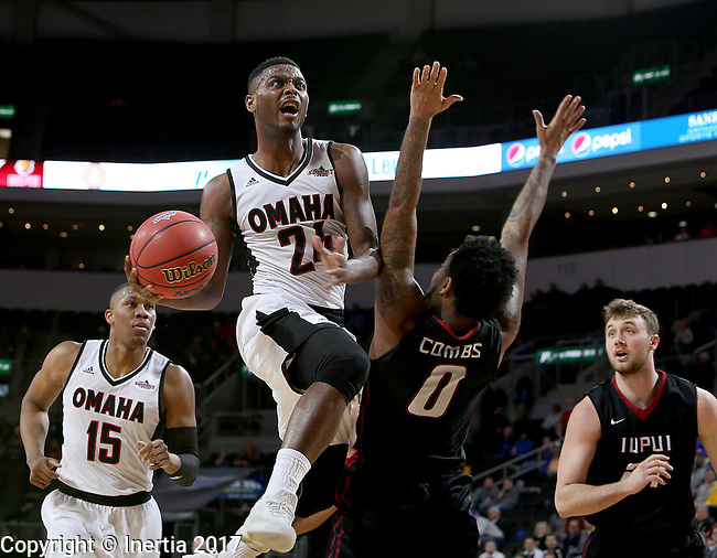 SIOUX FALLS, SD: MARCH 6: Tra-Deon Hollins #24 from Omaha takes the ball to the basket against Darell Combs #0 from IUPUI during the Summit League Basketball Championship on March 6, 2017 at the Denny Sanford Premier Center in Sioux Falls, SD. (Photo by Dave Eggen/Inertia)