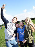 Dublin player Paul Flynn takes a selfie with girls from Newtown Blues GFC. Photo:Colin Bell/pressphotos.ie