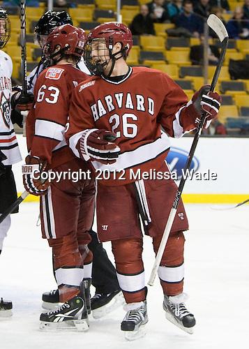 Luke Greiner (Harvard - 26) - The Harvard University Crimson defeated the Northeastern University Huskies 3-2 in the 2012 Beanpot consolation game on Monday, February 13, 2012, at TD Garden in Boston, Massachusetts.