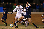24 November 2013: Wake Forest's Ian Harkes (16) and Navy's Guy Skord (22). The Wake Forest University Demon Deacons played the Naval Academy Midshipmen at Spry Stadium in Winston-Salem, NC in a 2013 NCAA Division I Men's Soccer Tournament Second Round match. Wake Forest won the game 2-1.