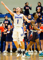 NWA Democrat-Gazette/JASON IVESTER<br /> Milacio Freeland, Rogers High senior, celebrates following a Rogers Heritage turnover in overtime on Tuesday, Jan. 12, 2016, at Rogers High.