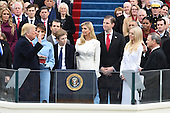 President  Donald J. Trump takes the Oath of Office from Chief Justice John Roberts at his inauguration on January 20, 2017 in Washington, D.C.  Trump became the 45th President of the United States.     <br /> Credit: Pat Benic / Pool via CNP