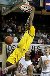 Jefferson's Terrence Jones yells after slam-dunking the ball over North Eugene in the 5A boys state championship at McArthur Court Friday March 13, 2009.
