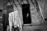At the door of their house in Attorba village, one of the countless little villages that populate the vast Bayt al-Faqih district in Hodeidah, Hend Mohammed (18) hold her severely malnourished one year old daughter, Rahaf.<br /> <br /> October 10th 2012.