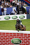 August 08, 2009: Cian O'Connor (IRL) and Markopoulo jump the wall. Land Rover International Puissance. Failte Ireland Horse Show. The RDS, Dublin, Ireland.