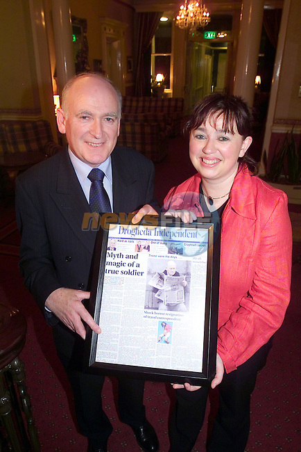 Marie Kierans Presenting retired Drogheda Independent Group Editor With a mock front Page of the Drogheda independent at his retirement function in the Boyne Valley Hotel...Picture Fran Caffrey Newsfile...This Picture is sent to you by:..Newsfile Ltd.The View, Millmount Abbey, Drogheda, Co Louth, Ireland..Tel: +353419871240.Fax: +353419871260.GSM: +353862500958.ISDN: +353419871010.email: pictures@newsfile.ie.www.newsfile.ie