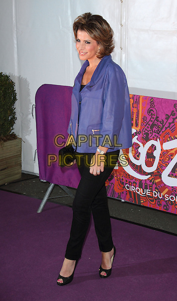 "Natasha Kaplinsky.VIP Night for Cirque du Soleil's new production, ""Kooza"" at the Royal Albert Hall, London, England..January 8th 2013.full length jacket blue black trousers side .CAP/ROS.©Steve Ross/Capital Pictures."