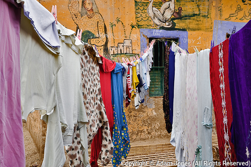 Laundry hanging on line in small alley in rural village outside of Luxor, Egypt