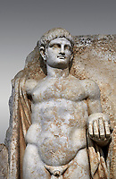 Detail of a Roman Sebasteion relief  sculpture of Emperor Nero with captive, Aphrodisias Museum, Aphrodisias, Turkey. <br /> <br /> Naked warrior emperor Nero holds the orb of world rule in one hand and crowns the military trophy with the other. Between the trophy and the emperor stands a bound captive boy. He wears long barbarian trousers and looks up at Nero.