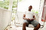 August 12, 2010. Durham, North Carolina..MLB player Fernando Perez sits on his front porch in the Waltown neighborhood of Durham and discusses his career at the Durham Bulls and in major league baseball.