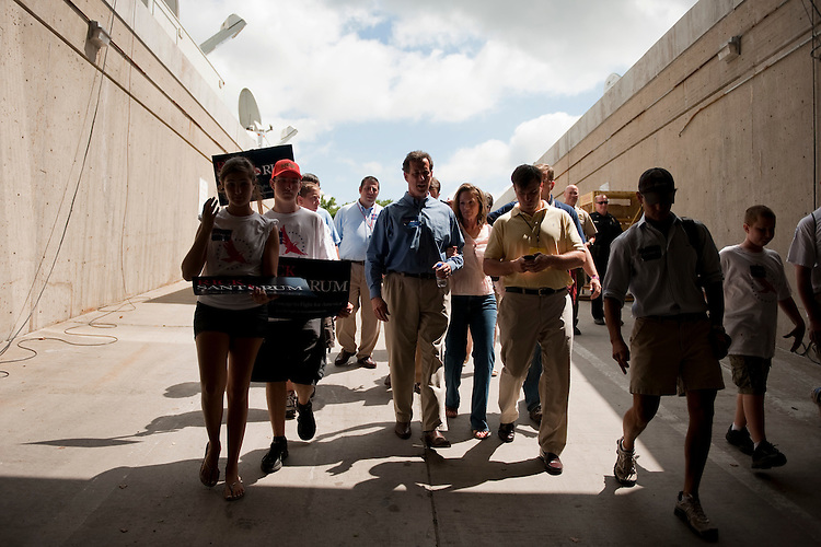 UNITED STATES - AUGUST 13:  Republican presidential candidate Rick Santorum, center, arrives to the Hilton Coliseum at Iowa State University, to address the crowd assembled for the Ames Straw Poll in Ames, Iowa.  (Photo By Tom Williams/Roll Call)