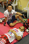 Dae Hwan Kim, Kamma Bantam weight champion, in locker room before fight<br /><br />MMA. Mixed Martial Arts &quot;Tigers of Asia&quot; cage fighting competition. Top professional male and female fighters from across Asia, Russia, Australia, Malaysia, Japan and the Philippines come together to fight. This tournament takes place in front of a ten thousand strong crowd of supporters in Pelaing Stadium. Kuala Lumpur, Malaysia. October 2015