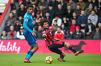 Nathan Ake of AFC Bournemouth clears from Alex Iwobi of Arsenal during the Premier League match between Bournemouth and Arsenal at the Goldsands Stadium, Bournemouth, England on 14 January 2018. Photo by Andy Rowland.