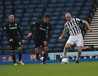 Jim Goodwin gets the better of Georgios Samaras as Gary Hooper watches in the St Mirren v Celtic Scottish Communities League Cup Semi Final match played at Hampden Park, Glasgow on 27.1.13.