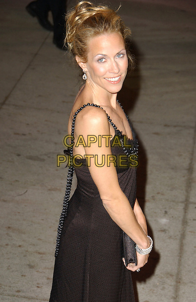 SHERYL CROW.The 2007 Vanity Fair Oscar Party Hosted by Graydon Carter held at Morton's, West Hollywood, California, USA, 25 February 2007..oscars half length black dress back over shoulder.CAP/ADM/GB.©Gary Boas/AdMedia/Capital Pictures.