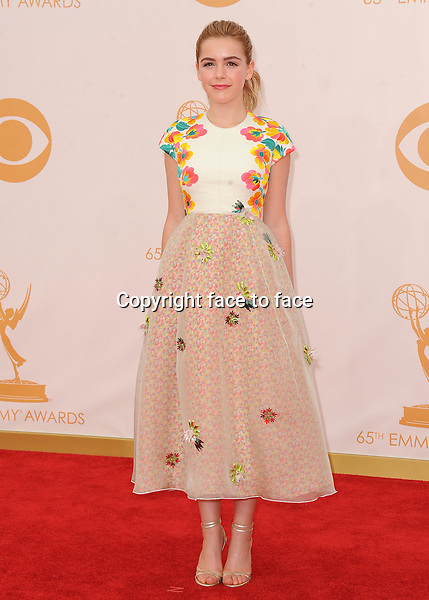 Kiernan Shipka arrives at the 65th Primetime Emmy Awards at Nokia Theatre on Sunday Sept. 22, 2013, in Los Angeles.<br />