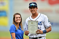 Asheville Tourists third baseman Colton Welker (24) is presented his player of the week award by Sam Fischer before a game against the Lexington Legends at McCormick Field on May 29, 2017 in Asheville, North Carolina. The Legends defeated the Tourists 5-2. (Tony Farlow/Four Seam Images)