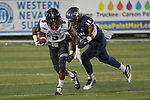 Hawaii receiver JoJo Ward (9) is chased by Nevada's Lawson Hall (30) in the first half of an NCAA college football game in Reno, Nev. Saturday, Sept. 28, 2019. (AP Photo/Tom R. Smedes)