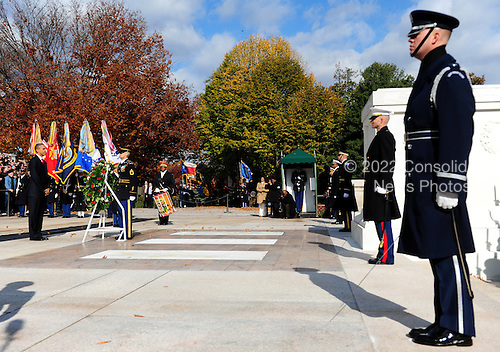 United States President Barack Obama participates in a moment of silence at the Tomb of the Unknown Solider at Arlington National Cemetery in Arlington, Virginia on Veterans Day, Friday, November 11, 2011.  .Credit: Kevin Dietsch / Pool via CNP
