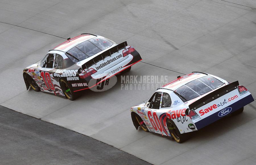 May 31, 2008; Dover, DE, USA; Nascar Nationwide Series driver Denny Hamlin (18) leads Carl Edwards (60) during the Heluva Good 200 at the Dover International Speedway. Mandatory Credit: Mark J. Rebilas-US PRESSWIRE