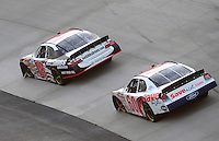 May 31, 2008; Dover, DE, USA; Nascar Nationwide Series driver Denny Hamlin (18) leads Carl Edwards (60) during the Heluva Good 200 at the Dover International Speedway. Mandatory Credit: Mark J. Rebilas-US PRESSWIRE
