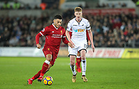 Alex Oxlade-Chamberlain of Liverpool moves past Sam Clucas of Swansea City during the Premier League match between Swansea City and Liverpool at the Liberty Stadium, Swansea, Wales on 22 January 2018. Photo by Mark Hawkins / PRiME Media Images.